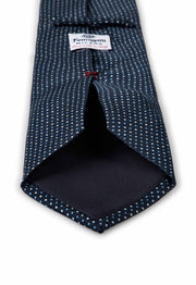 the vision of the hand made tie with light blue and white dots