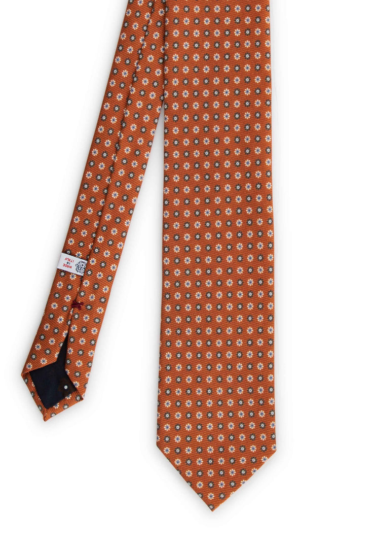 frontal view of the orange printed hand made tie