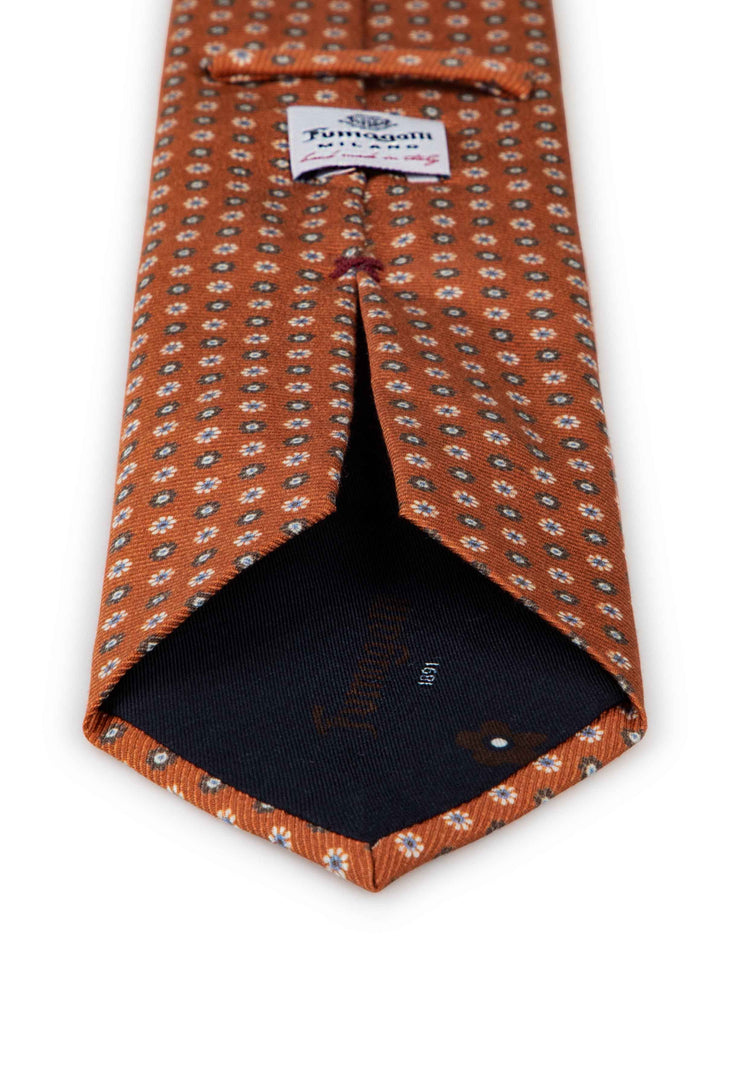 hand made printed orange tie with brown and white floral pattern and fumagalli label