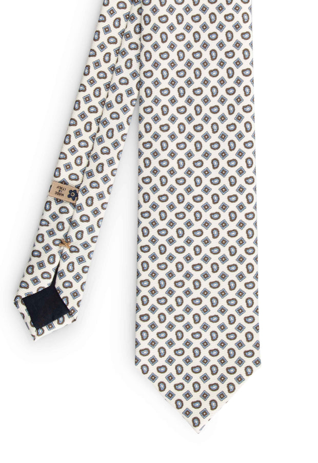 frontal view of the white paisley patterned silk printed tie