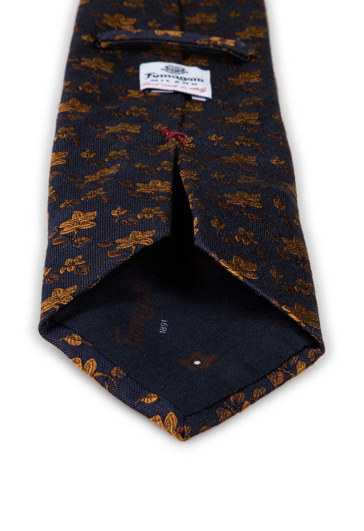 dark blue and gold flowers on a silk hand made tie