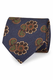 on a blue background on this tie stands out brown big flowers and some paisley design green
