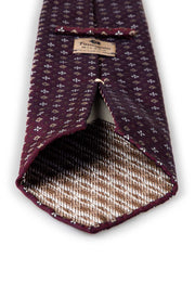 handmade jacquard tie with hand-rolled border with brown detail and an unlined finiture