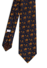 front vision of the hand made tie on a dark blue background on yellow gold floral