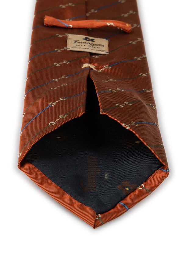 the vision of the hand made orange tie with little stripes brown and blue