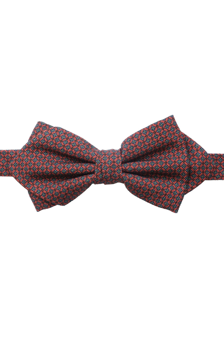 This bow tie has a pesticular shape, it's orange with little diamonds