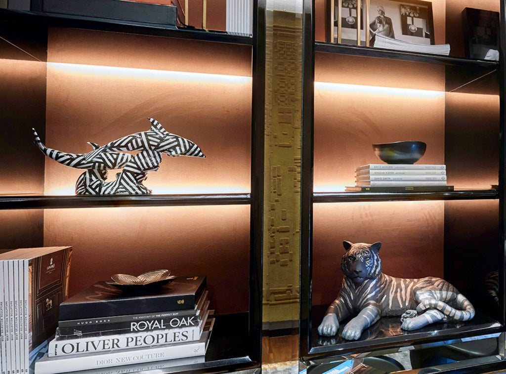 Lladro Sculptures On Display Shelves