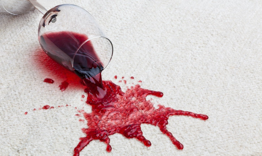 Red Wine Spill On White Area Rug