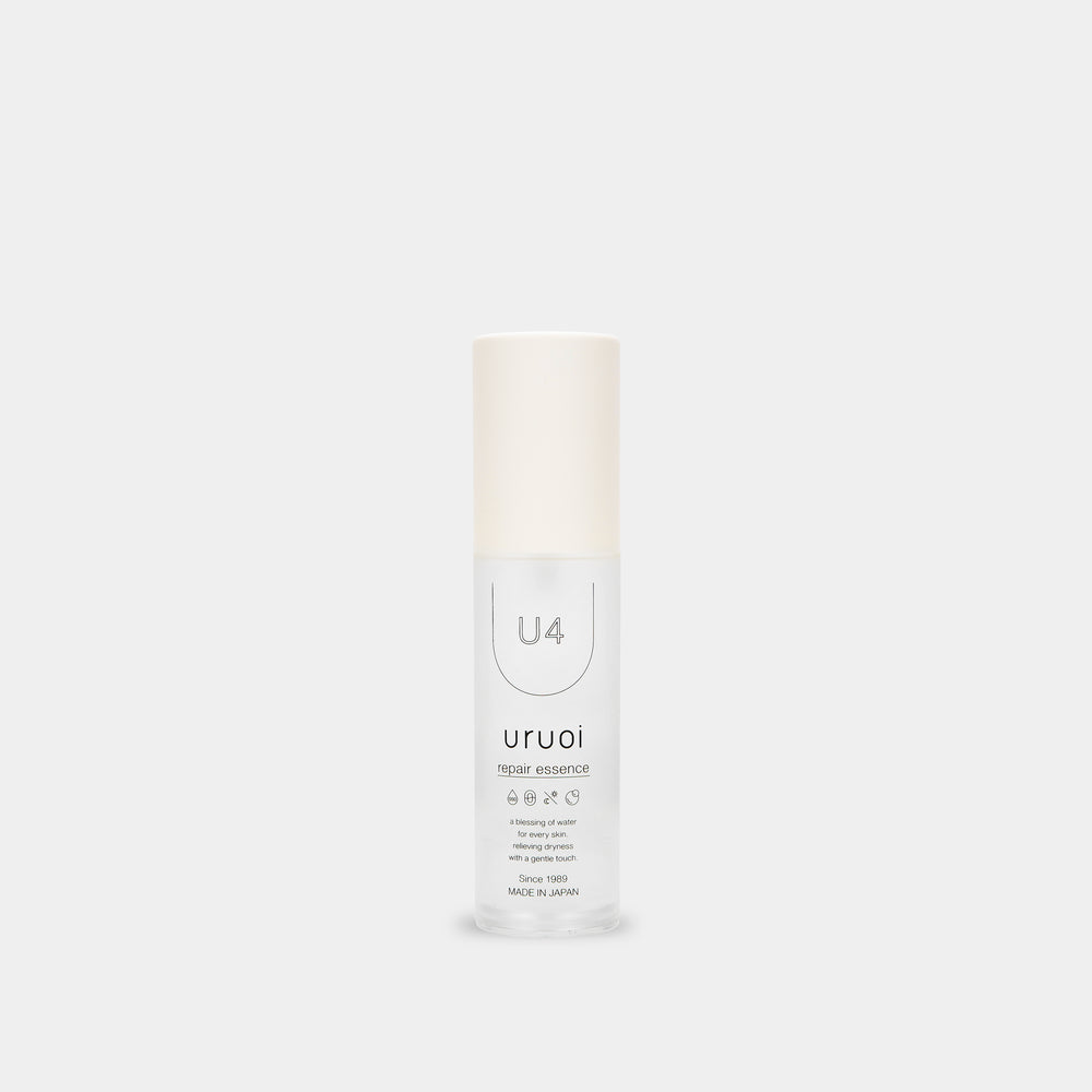 minimalistic monotone forward facing product bottle that says 'repair essence' with light gray white background