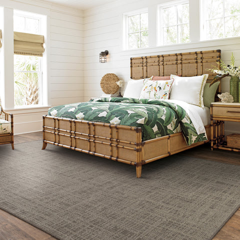 brown rug under tommy bahama bed