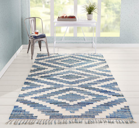 blue diamond patterned area rug in modern room.