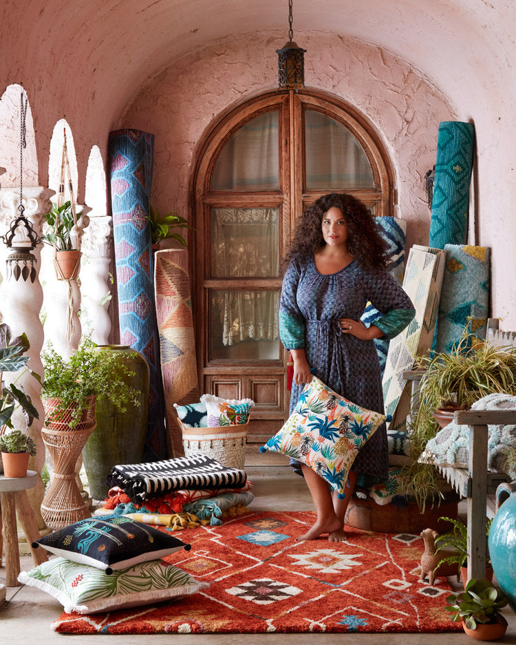 Justina Blakeney posing with rugs