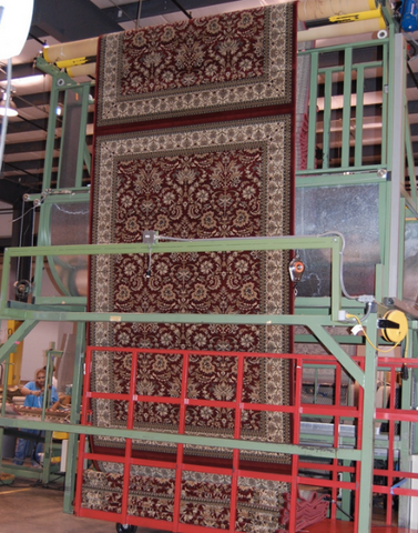 three machine made rugs displayed on a machine loom
