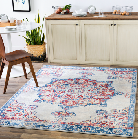 pink and blue rug with medallion in the center in a kitchen