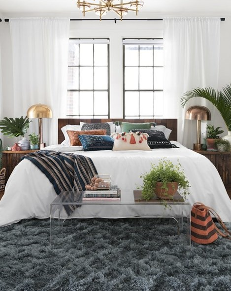 teal shag rug under bohemian bed