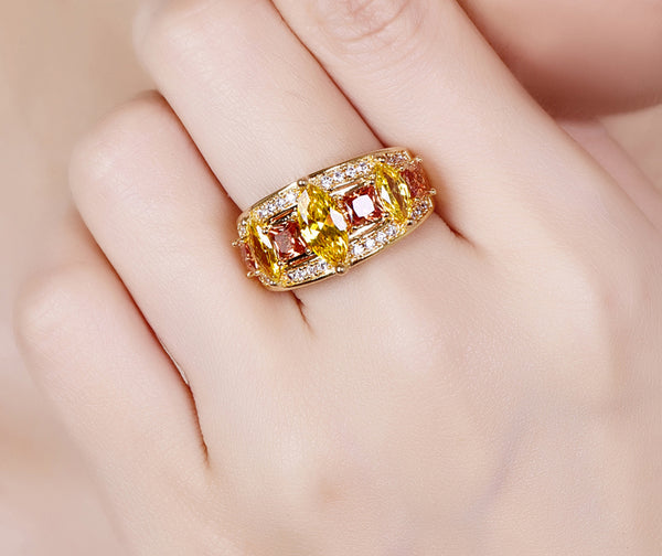 Marquise Cut Yellow & Red Zircon in hand