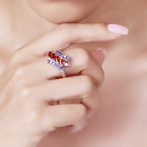 Marquise Red Purple & Blue Pink CZ Silver Ring in hand
