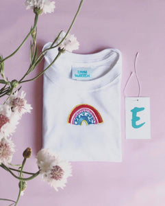 t-shirt with rainbow embroidered design