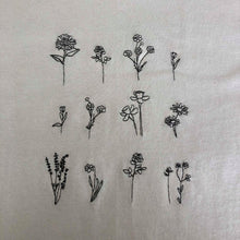Load image into Gallery viewer, t-shirt with floral embroidered design