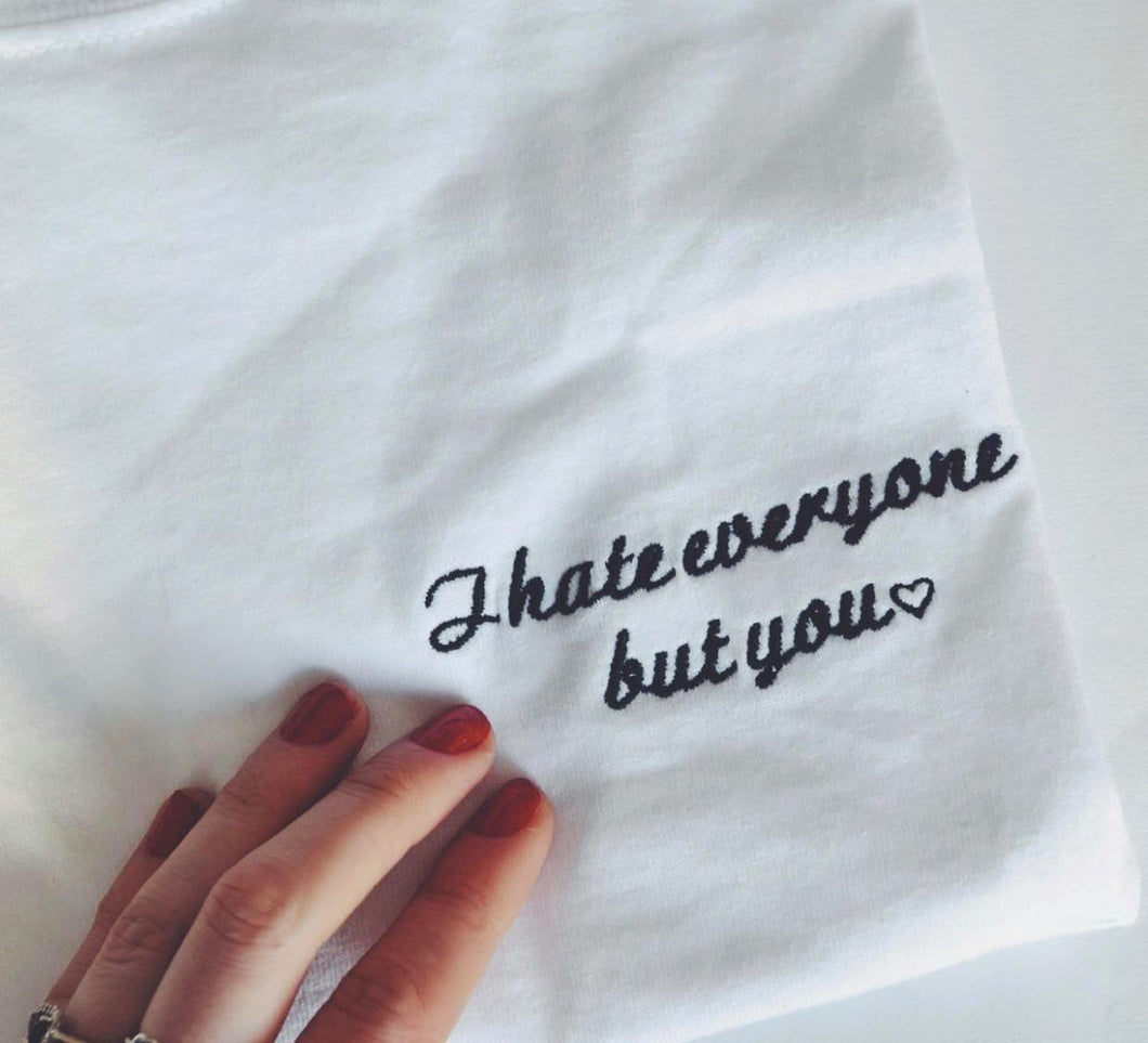 organic t-shirt with I hate everyone but you embroidered slogan design