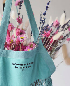 Embroidered 'market treats' sunflowers are pretty bag