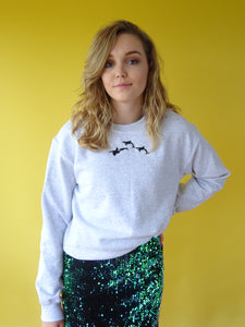 Embroidered trio orca ash coloured Sweater