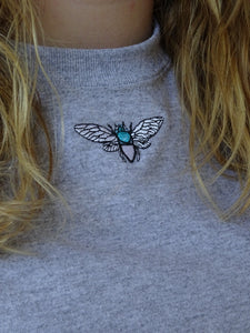 t-shirt with mini turquoise moth embroidery