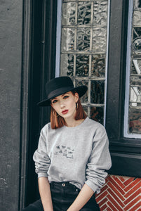 unisex sweatshirt with stop buggin embroidered slogan