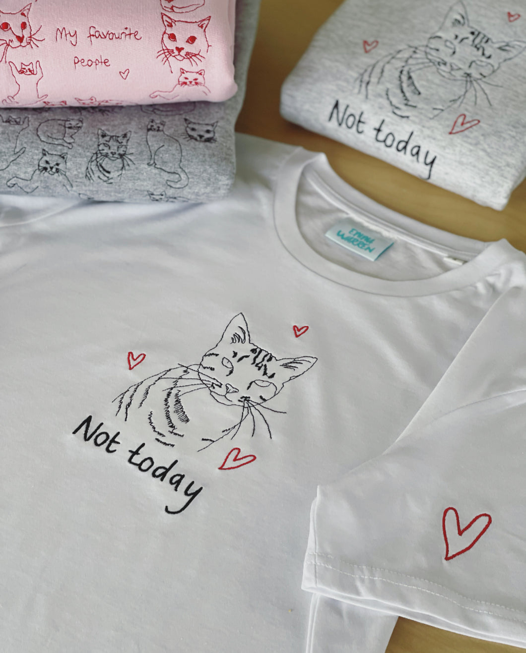 Not today slogan and cat embroidered organic t-shirt with heart sleeve