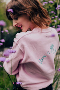 unisex sweatshirt in grey with Have a nice day and daisy embroidered slogan