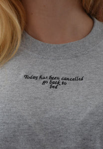 t-shirt with slogan today is cancelled go back to bed embroidery