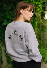 Load image into Gallery viewer, unisex sweatshirt in grey with Have a nice day and daisy embroidered slogan