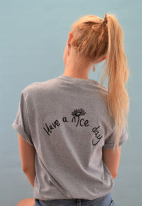 t-shirt with have a nice day back embroidered slogan with daisy