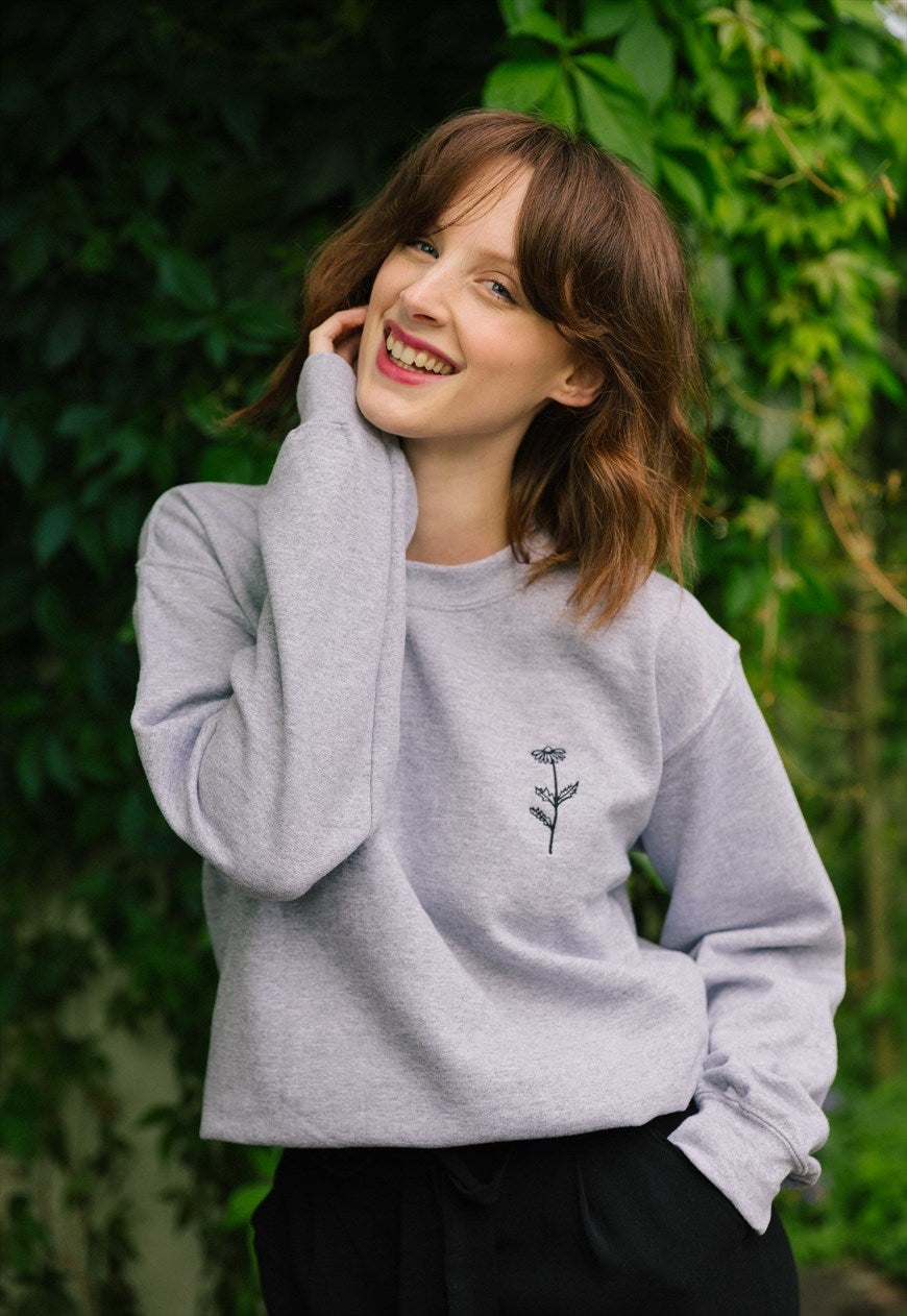 unisex sweatshirt in grey with daisy embroidery