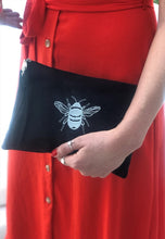 Load image into Gallery viewer, Canvas clutch bag in black with silver bee embroidery