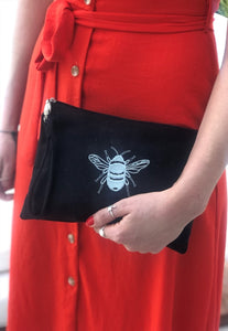 Canvas clutch bag in black with silver bee embroidery
