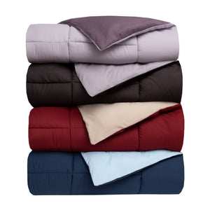 a set of down comforters in different colors