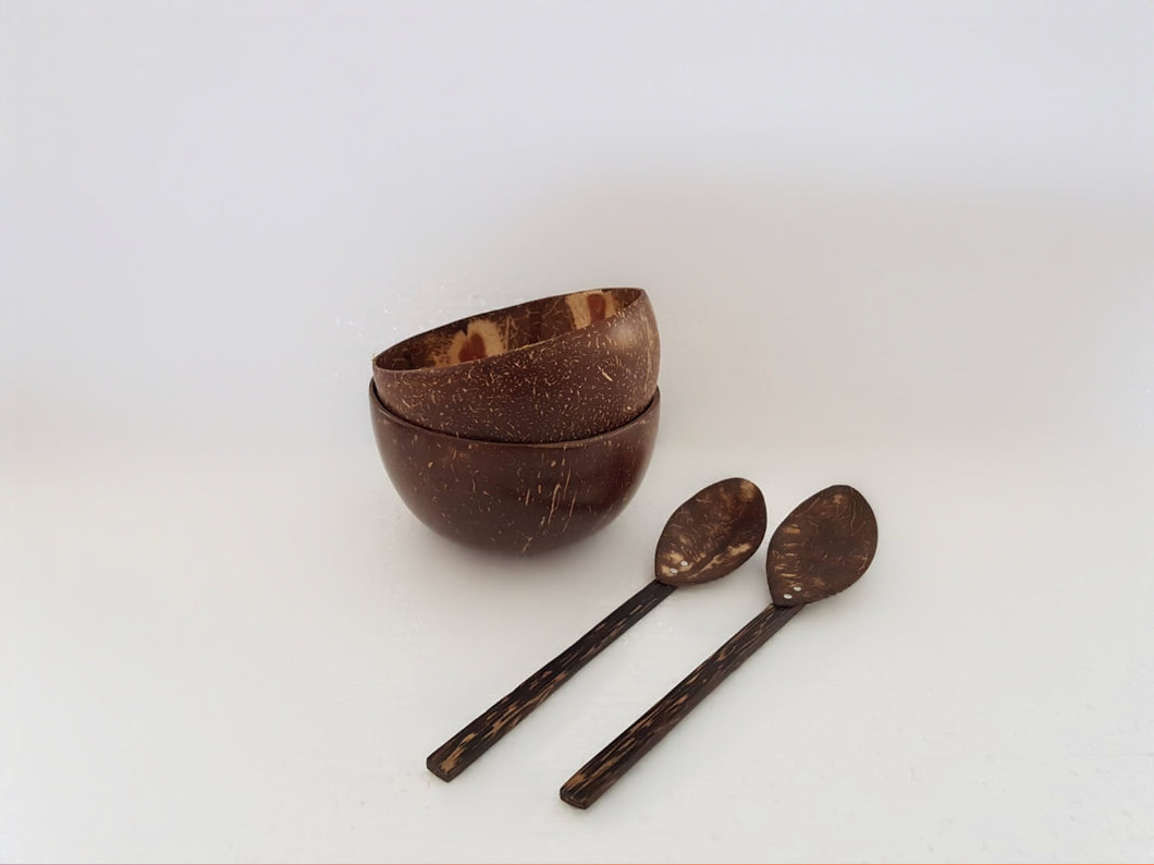 A dual set of coconut bowls and spoons