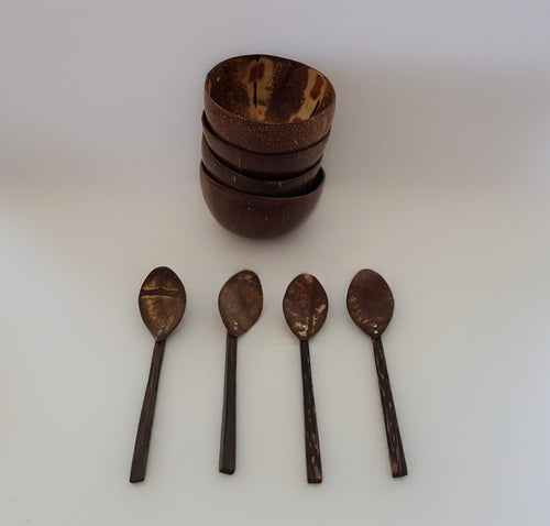 A set of 4 coconut bowls with spoons.