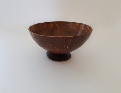A coconut bowl with stand