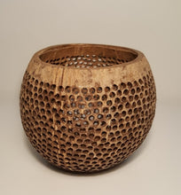 A coconut shell lamp side view