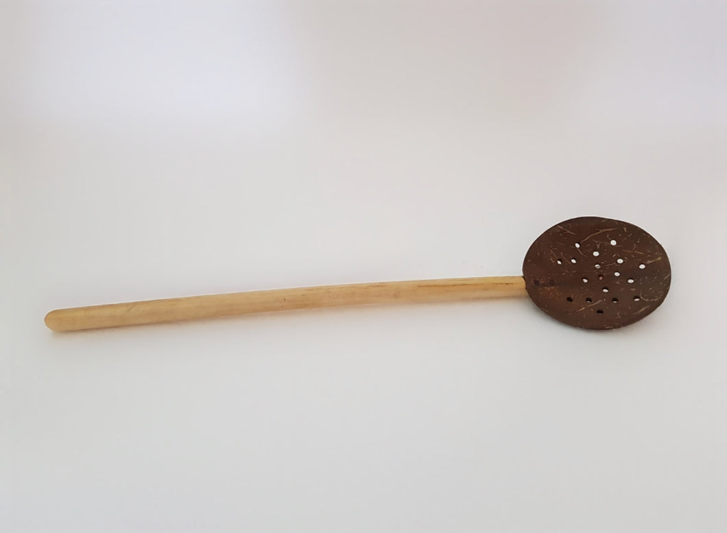 a light wooden frying spoon
