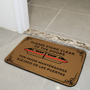 Please stand clear off the door mat