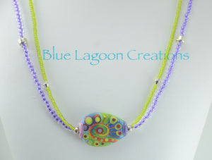 Bright Green and Purple 2 strand Necklace with Lampwork Bead by Michou
