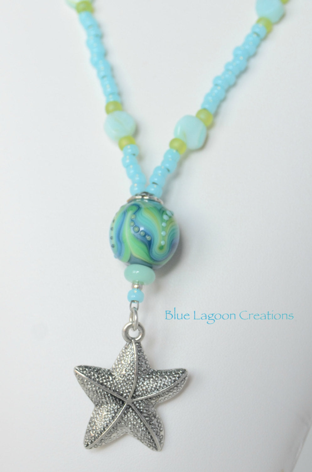 Green and Blue Starfish Pendant Necklace with Lampwork Bead by Michal Silberberg