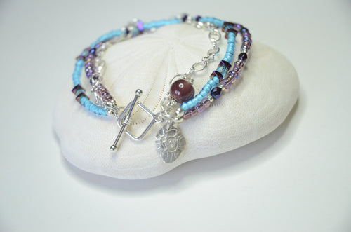 Aqua and Purple Fine silver seashell charm multi strand bracelet