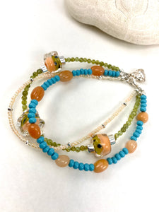 Three Strand Peach and Blue Beaded Bracelet with Buddha Charm