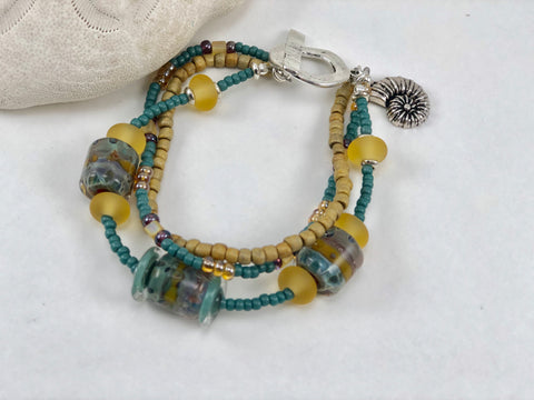 Teal and Gold Glass Bead Three Strand Ocean Bracelet