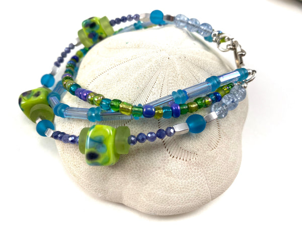 Three Strand Lime Green and Purple Beaded Bracelet