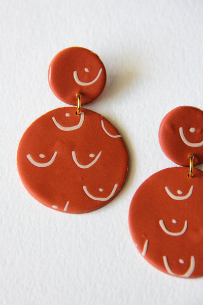 Rust Clay Breast Earrings